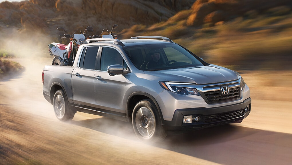 Image of 2019 Ridgeline driving on dirt road