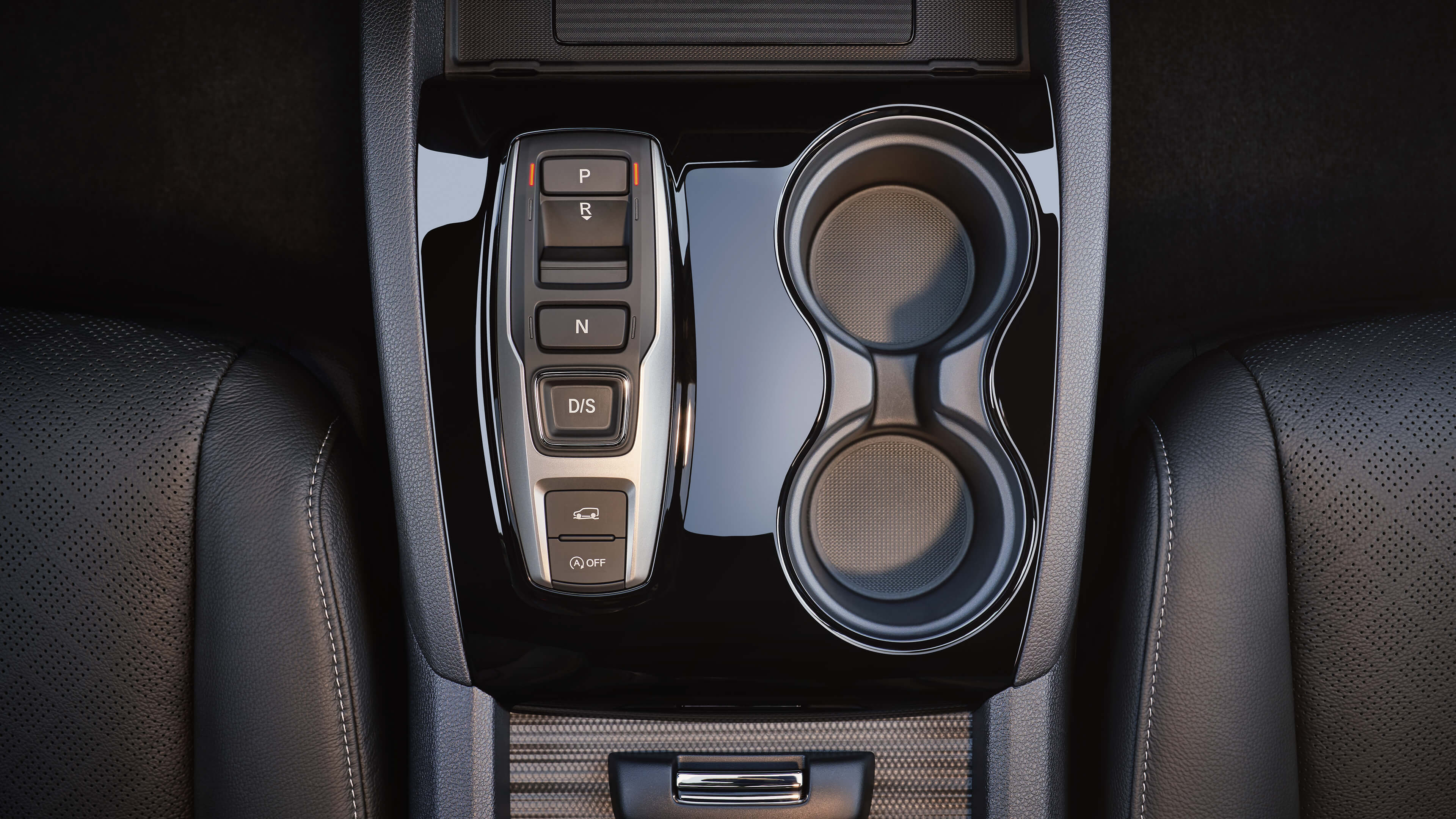Interior overhead view of 2020 Honda Passport gear shifter and cupholders.