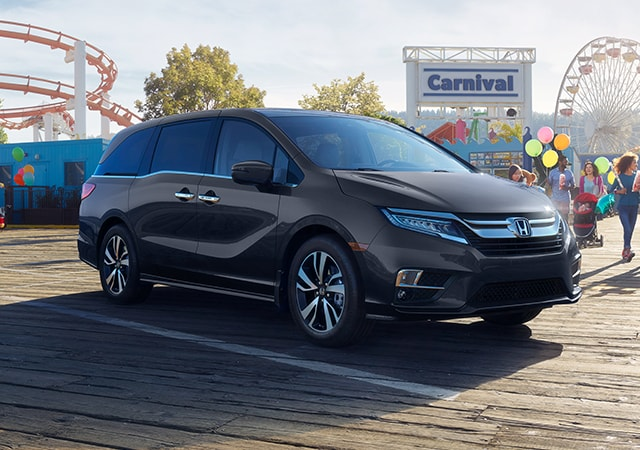 Image of the 2020 Honda Odyssey at an amusement park.