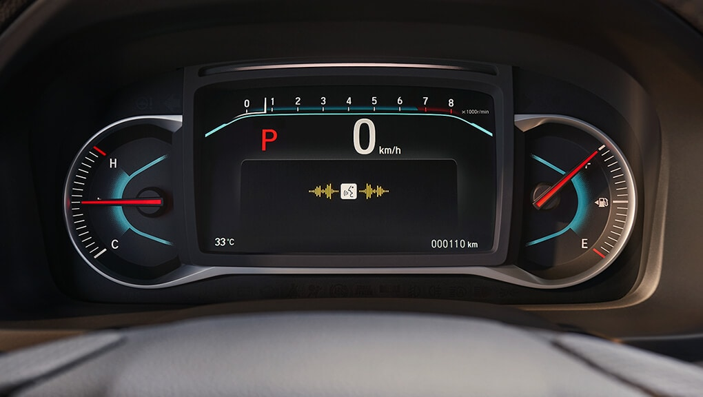 Interior view of 2019 Honda Passport control cluster and bilingual voice recognition system.