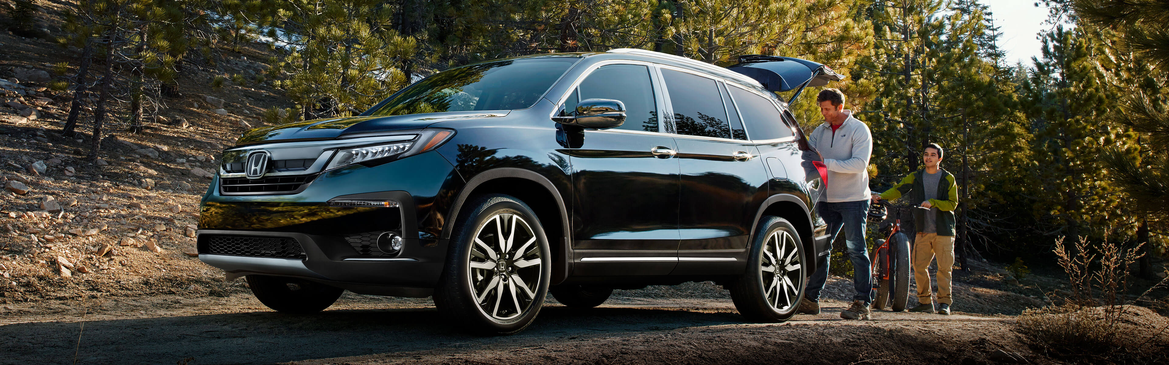 2018 Honda Pilot parked in forest