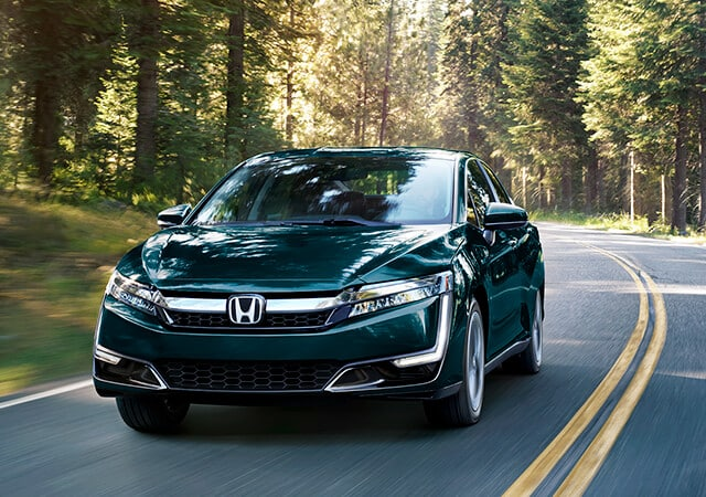 2018 Honda Clarity driving through forest