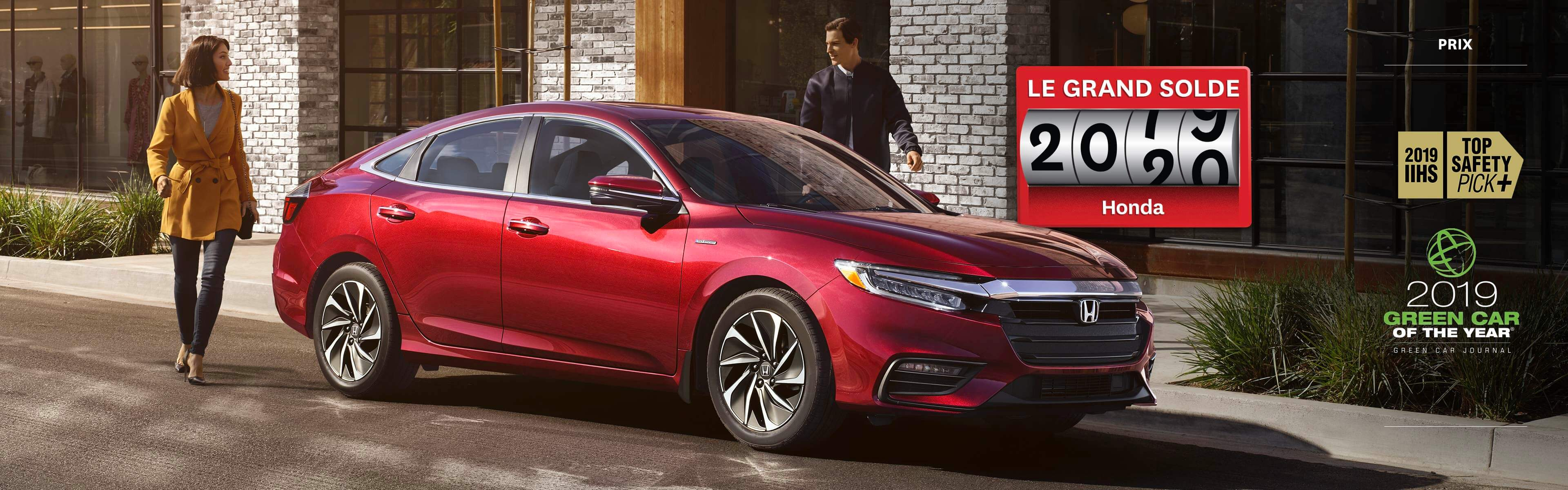 Honda Insight rouge 2019 stationnée