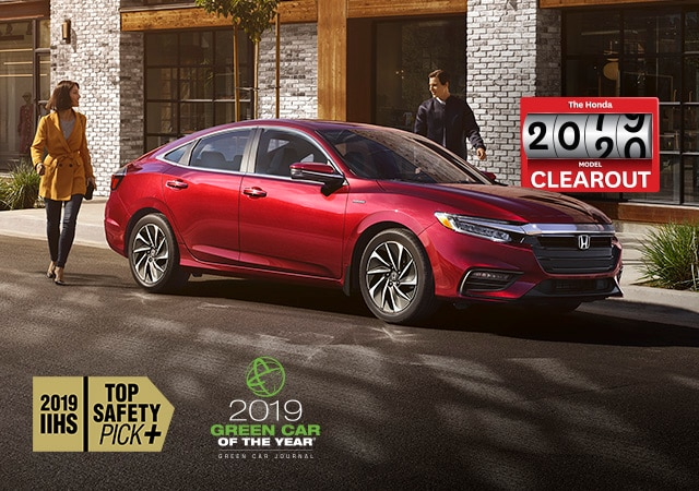 Red 2019 Honda Insight parked