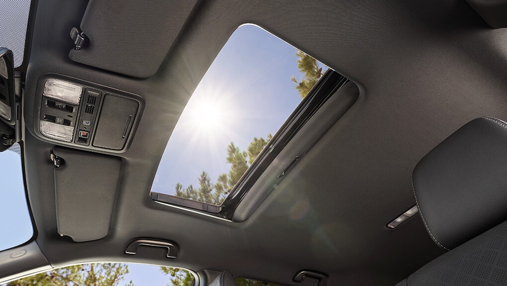 Low angle view of 2019 Honda Passport's open one-touch power moonroof with tilt feature.