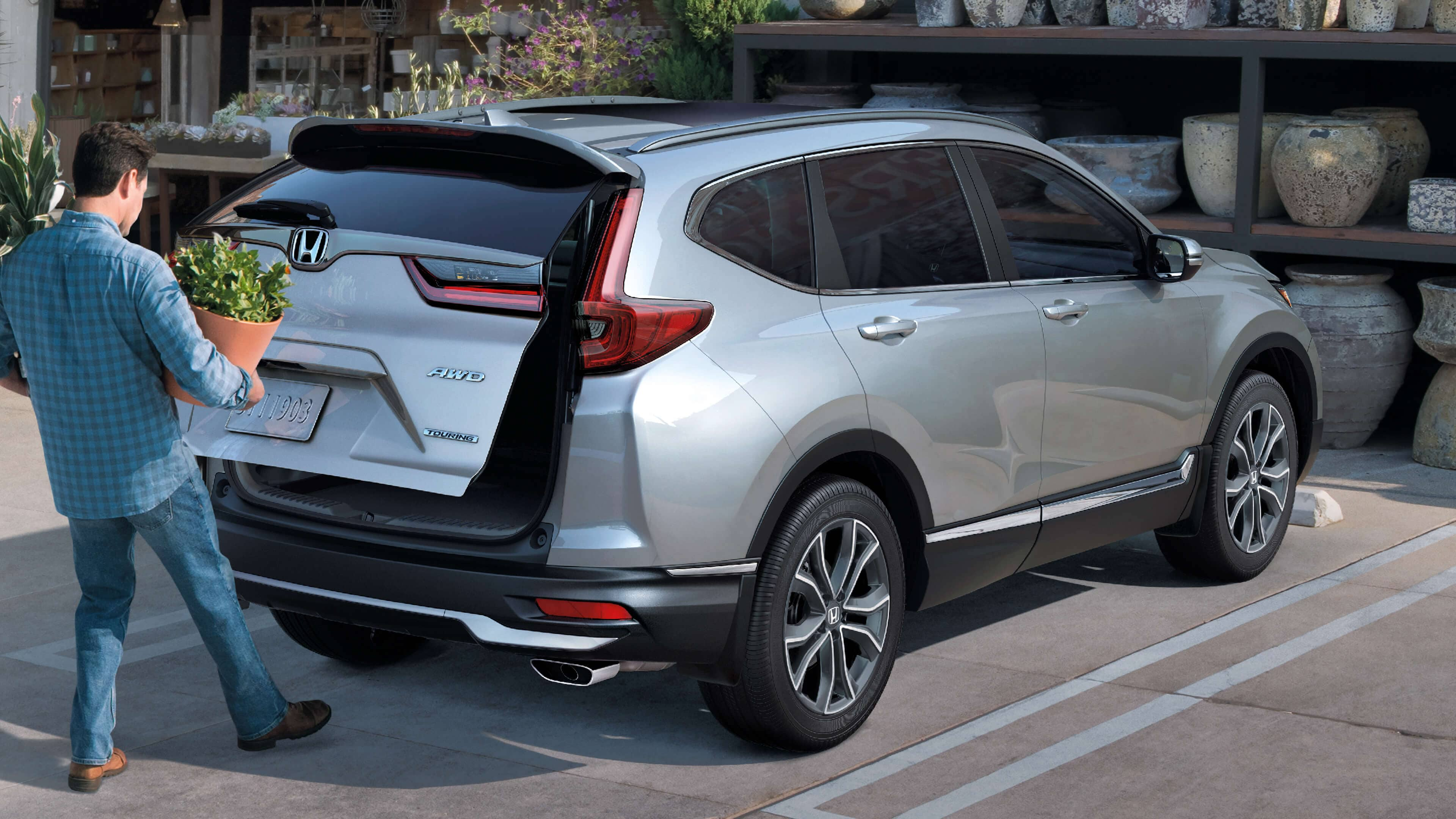 Rear passenger-side view of the 2021 Honda CR-V Touring demonstrating hands-free access power tailgate.
