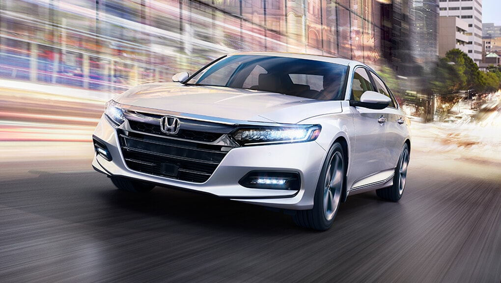 Image of 2020 Honda Accord Hybrid on city street.